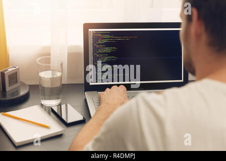 website programmer working on laptop at office - Stock Photo