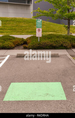 EVERETT, WA, USA - JUNE 2018: Parking bay at the Boeing Museum of flight centre reserved for visitors with vehicles which require electric charging - Stock Photo