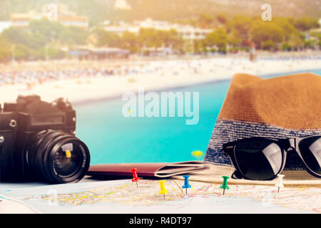 summer holidays - vacation accessories and map on beach resort background - Stock Photo