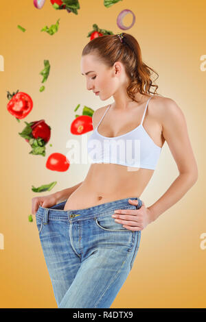 Woman became skinny and wearing old jeans - Stock Photo