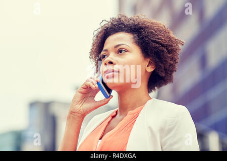 african businesswoman calling on smartphone - Stock Photo