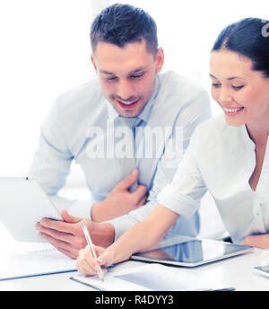 business team working with tablet pcs - Stock Photo