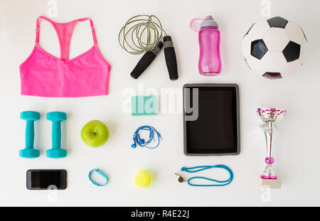 close up of tablet pc, cellphone and sports stuff - Stock Photo