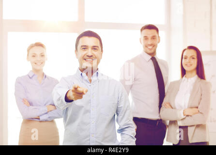 businessman in office pointing finger at you - Stock Photo