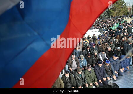 NAZRAN, RUSSIA - NOVEMBER 27, 2018: Ingush men pray during a protest in the city of Nazran against a border agreement, which was signed by the leaders of Russia's Republic of Ingushetia and Russia's Chechen Republic in September 2018; the border hadn't been clearly defined since the break-up of the Chechen-Ingush Autonomous Soviet Socialist Republic in 1991; according to the new agreement, Ingushetia and Chechnya are to swap uninhabited territories in Chechnya's Nadterechny District and Ingushetia's Sunzha District; the leader of Ingushetia has referred the controversial border agreement to th - Stock Photo