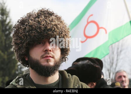 NAZRAN, RUSSIA - NOVEMBER 27, 2018: A young Ingush man in a fur hat is pictured during a protest in the city of Nazran against a border agreement, which was signed by the leaders of Russia's Republic of Ingushetia and Russia's Chechen Republic in September 2018; the border hadn't been clearly defined since the break-up of the Chechen-Ingush Autonomous Soviet Socialist Republic in 1991; according to the new agreement, Ingushetia and Chechnya are to swap uninhabited territories in Chechnya's Nadterechny District and Ingushetia's Sunzha District; the leader of Ingushetia has referred the controve - Stock Photo