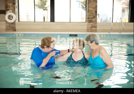Old Ladies Chilling in Pool - Stock Photo
