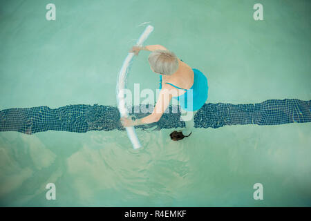 Senior Woman Working Out in Pool - Stock Photo