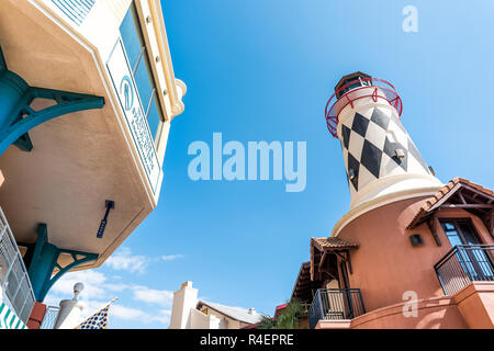 Destin, USA - April 24, 2018: City town village Pirate's Alley looking up low angle on Harbor Boardwalk, lighthouse, in Florida panhandle gulf of mexi