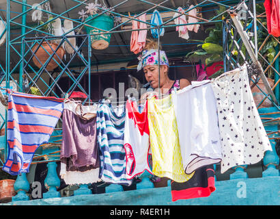 Havana, Cuba - 25 July 2018: A Cuban women is hanging her laundry out to dry on her balcony in Havana Cuba. - Stock Photo