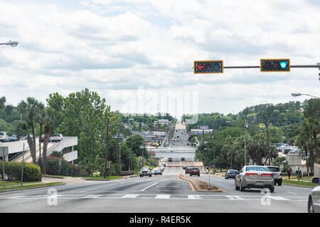 Tallahassee, USA - April 26, 2018: Capital city street road highway with cars in traffic in Florida day with light, hill - Stock Photo