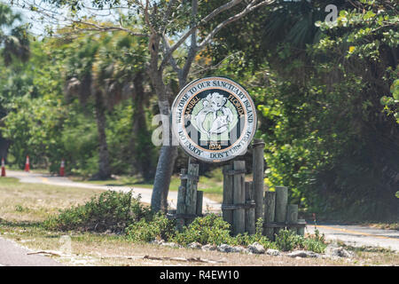 Sanibel Island, USA - April 29, 2018: Welcome sign in park by beach near Fort Myers, Florida, sanctuary incorporated on road - Stock Photo