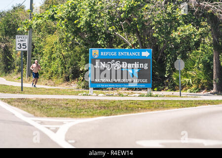 Sanibel Island, USA - April 29, 2018: JN Ding Darling national wildlife refuge park by beach and road in Fort Myers, Florida sign entrance - Stock Photo