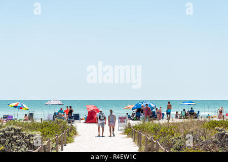 Sanibel Island, USA - April 29, 2018: Bowman's beach with sandy trail, path, walkway, fence, many people, crowd crowded coast, coastline shelling, bea - Stock Photo