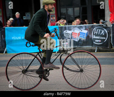 Entrant on old safety bicycle near finishing line Madiera Drive on London to Brighton Veteran Car run 4th November 2018 - Stock Photo