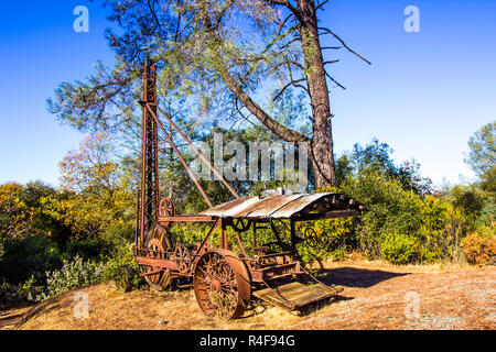 Vintage Mining Drilling Equipment Abandoned On Hill - Stock Photo