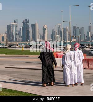 QATAR, DOHA - FEBRUARY 2018: Arabian Middle Eastern Boys on Crossroad Looking on the Doha Skyline View. Qatar, Middle East - Stock Photo
