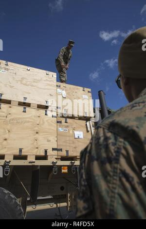 U.S. Marine Corps Cpl. Mohamed Hussain and Lance Cpl. Rodney Raber, motor vehicle operators with 2nd Transport Support Battalion, place boxes on a truck during Strategic Mobility Exercise 17 (STRATMOBEX) near Stjordal, Norway, May 2, 2017.  STRATMOBEX is a logistics-based exercise involving the preparation and movement of equipment from cave sites of the Marine Corps Prepositioning Program in Norway. - Stock Photo