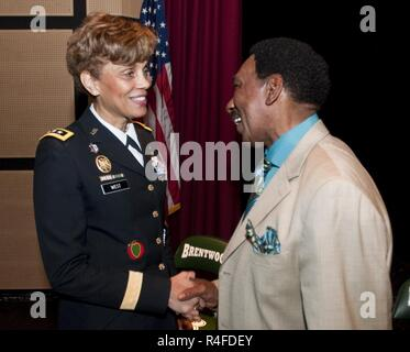 U.S. Army Lt. Gen. Nadja West, U.S. Army surgeon general and commander, U.S. Army Medical Command, shakes the hand of Dr. Levi McIntyre, superintendent of schools, Brentwood Union Free School District, at a school event in Brentwood Hamlet, Islip, New York, May 2, 2017. West was invited to speak at Brentwood High School after student Ahmad Perez reached out to her looking to learn more about the medical career field. - Stock Photo