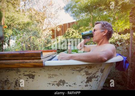 Mature Man Drinking Coffee in Bathtub