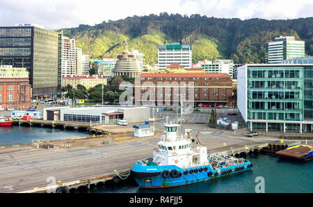 Wellington, New Zealand - August 24, 2017: Early morning in the capital city as viewed from a ferry leaving port from Lambton Harbour. - Stock Photo