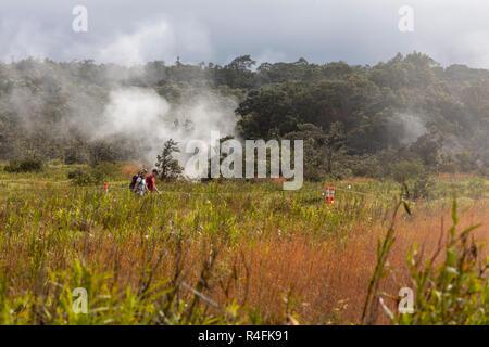 Hawaii Volcanoes National Park, Hawaii - Hikers near steam vents from the Kilauea volcano. - Stock Photo