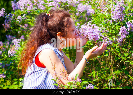 Young woman smelling flowers. Istanbul,Turkey. - Stock Photo