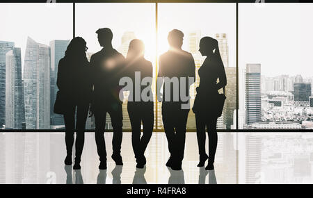 people silhouettes over window and city background - Stock Photo