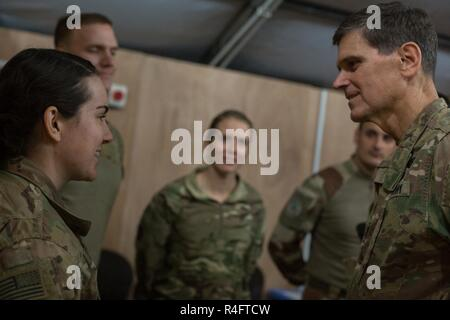 U.S. Army Gen. Joseph Votel, Commander of the United States Central Command, thanks U.S and coalition forces at Qayyarah West Airfield, Iraq, Oct. 25, 2016. The United States stands with a coalition of more than 60 international partners to assist and support the Iraqi security forces to degrade and defeat the Islamic State of Iraq and the Levant. - Stock Photo