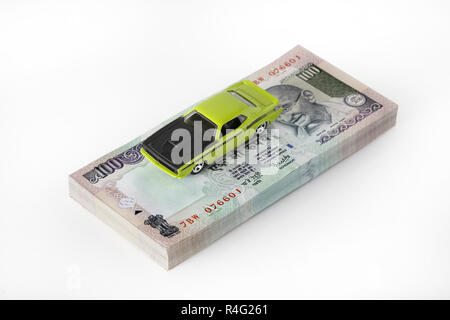 Car on money stack - Stock Photo