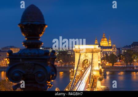 Chain Bridge (Szechenyi Bridge) and St Stephen's Basilica at dusk, Budapest, Hungary - Stock Photo