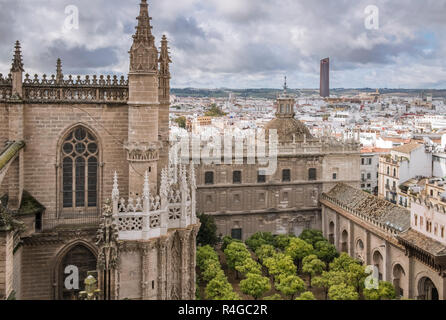 Seville cathedral  and surrounding section of Seville city, viewed from the Giralda bell tower, Seville, Andalucia, Spain - Stock Photo