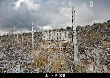 ID00704-00...IDAHO - Fence along the backside of Bath Rock on a stormy day in the City of Rocks National Reserve. - Stock Photo