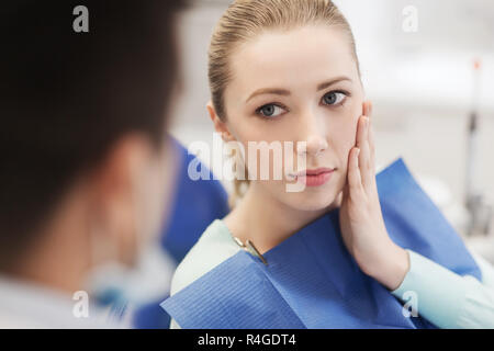 male dentist with woman patient at clinic - Stock Photo