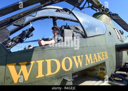 John Sawicki from Columbia, South Carolina, sits in the cockpit of a Cobra aircraft from the North Carolina Vietnam Helicopter Pilot's Association during the South Carolina National Guard Air and Ground Expo at McEntire Joint National Guard Base, South Carolina, May 6, 2017. This expo is a combined arms demonstration showcasing the capabilities of South Carolina National Guard Airmen and Soldiers while saying thank you for the support of fellow South Carolinians and the surrounding community. - Stock Photo