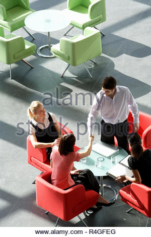 Four business colleagues holding a business meeting - Stock Photo