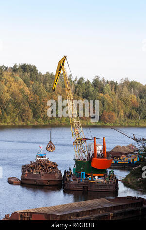 logging on a river - Stock Photo