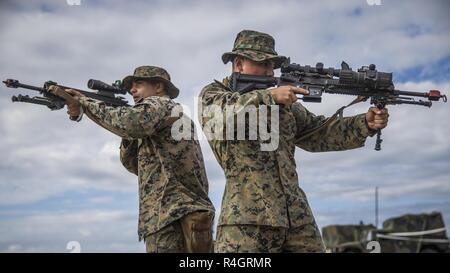 Lance Cpl. Dominic Lucas (left) and Lance Cpl. Abraham Vallejoibarra, riflemen with Kilo Company, 3rd Battalion, 5th Marine Regiment, perform basic room clearing techniques during a helicopter raid rehearsal at Camp Pendleton, Calif., Oct. 3, 2018. These rehearsals help build muscle memory and reinforce techniques, tactics and procedures before the execution of the mission. - Stock Photo
