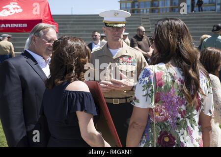 CHATTANOOGA, Tenn. – Maj. Gen. Burke W. Whitman, commanding general of 4th Marine Division, talks to the families of Gunnery Sgt. Thomas Sullivan and Staff Sgt. David Wyatt at Ross's Landing in Chattanooga, Tenn., May 7, 2017. Sullivan and Wyatt were posthumously awarded the medal for their actions during the July 16, 2015 shooting that occurred at the Naval Reserve Center Chattanooga and left two other Marines and a sailor dead. - Stock Photo