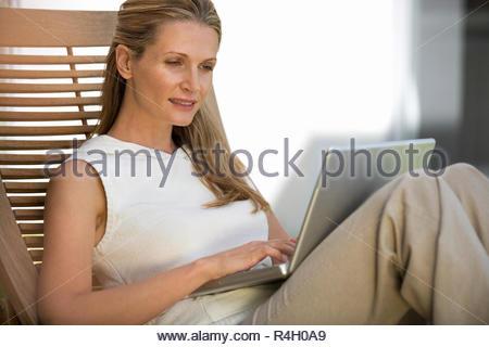 A woman using a laptop - Stock Photo