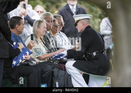 Rebecca Bailey, sister of U.S. Marine Corps Lance Cpl. John Killen, received the U.S. flag during Killen's funeral in Section 60 of Arlington National Cemetery, Arlington, Virginia, Sept. 27, 2018.  Killen was part of a group burial repatriation with Capt. John House, II; Lance Cpl. John Killen, III; Cpl. Glyn Runnels, Jr.; and Lance Cpl. Merlin Allen, all U.S. Marine Corps, as well as U.S. Navy Hospital Corpsman Michael Judd.     From the Defense POW/MIA Accounting Agency news release: On June 30, 1967, House was the pilot of a CH-46A Sea Knight helicopter, who with three other crew members,  - Stock Photo