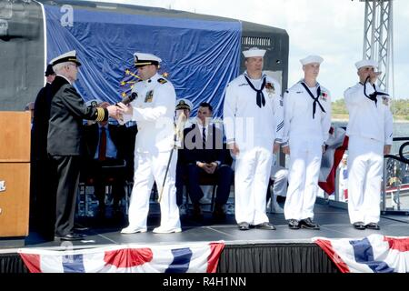 PORT CANAVERAL, Fla. (Sept. 29, 2018) Capt. Gerald Peddicord (ret.), a plank owner on USS Indiana (BB 58), presents Lt. Keenan Coleman, the ships' Weapons Officer and first Officer of the Deck, with the Long Glass prior to USS Indiana (SSN 789) setting the first watch.  U.S. Navy's 16th Virginia-class fast-attack submarine and the third ship named for the State of Indiana. - Stock Photo