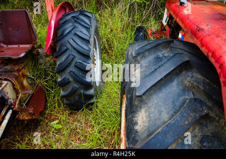 Closeup of two vintage tractors - Stock Photo