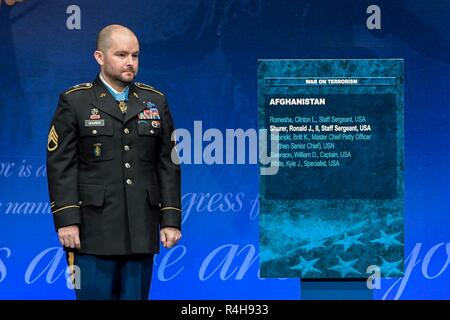 A Medal of Honor Induction Ceremony is held in honor of former U.S. Army Staff Sgt. Ronald J. Shurer II at the Pentagon in Arlington Va., Oct. 2, 2018. Shurer was awarded the Medal of Honor Oct. 1, 2018 for actions while serving a senior medical sergeant with the Special Forces Operational Detachment Alpha 3336, Special Operations Task-Force-33, in support of Operation Enduring Freedom in Afghanistan on April 6, 2008. - Stock Photo