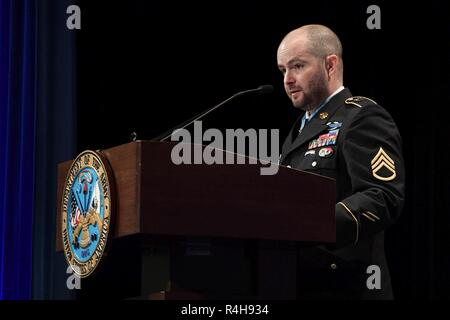 Former U.S. Army Staff Sgt. Ronald J. Shurer II  gives his remarks during the Medal of Honor Induction Ceremony at the Pentagon in Arlington Va., Oct. 2, 2018. Shurer was awarded the Medal of Honor Oct. 1, 2018 for actions while serving a senior medical sergeant with the Special Forces Operational Detachment Alpha 3336, Special Operations Task-Force-33, in support of Operation Enduring Freedom in Afghanistan on April 6, 2008. - Stock Photo