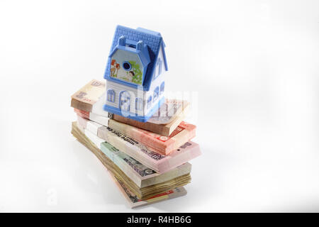 House on money stack - Stock Photo
