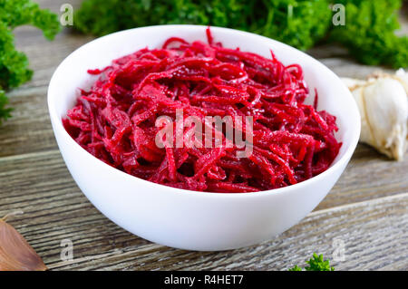 Vegetable salad from fresh  beets. Korean spicy salad in bowl on a wooden table. Top view. Vitamin menu. Vegan cuisine. - Stock Photo