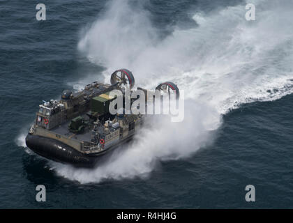 The U.S. Navy Landing Craft, Air Cushioned hovercraft transports Marines and equipment with Special Purpose Marine Air-Ground Task Force - Peru during a humanitarian assistance and disaster relief exercise off of the coast of Chorrillos Beach near Lima, Peru, Nov. 24, 2018.  SPMAGTF-Peru's goal is to demonstrate humanitarian assistance and disaster relief response by bringing together the capabilities of U.S. Marines and sailors aboard the Somerset and Peruvian naval forces as a multinational maritime task force. The integrated mission is part of U.S. Southern Command's Enduring Promise initia - Stock Photo