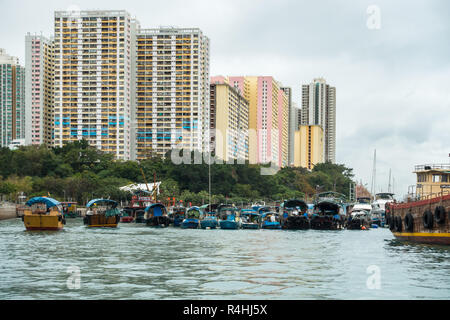 Sampan cruise in Aberdeen harbour, famous for the floating village with old junks and house boats, Hong Kong - Stock Photo