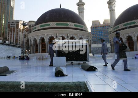 Mecca-March 5, 2017: janitors at the Haram Mosque are installing carpets on the floor, Saudi Arabia - Stock Photo